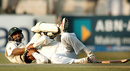 Tendulkar and Yousaf lies in pain.