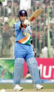 Sachin Tendulkar raises his bat after his century