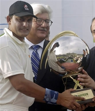 Mohammad Azharuddin holds the winning trophy