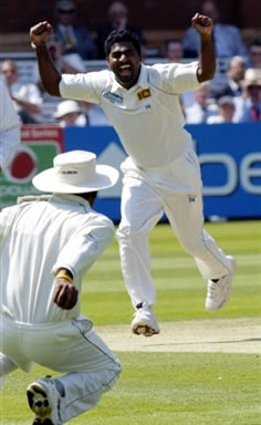 Muralitharan celebrates the dismissal of Strauss