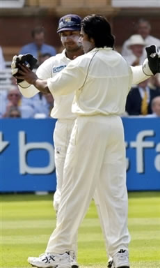 Vaas celebrates with Sangakkara the dismissal of Pietersen