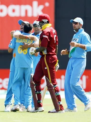 India team celebrate Gayle's dismissal