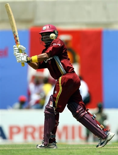 Sarwan plays a shot