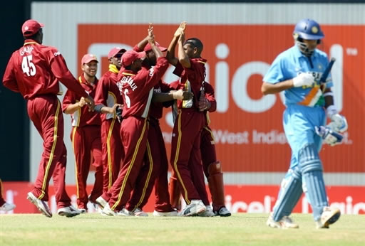 West Indies players celebrate the dismissal of Dravid