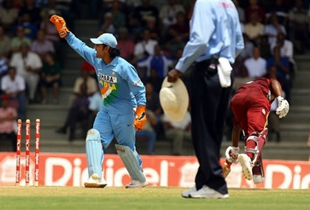 Dhoni appeals for a successful run out of Lara
