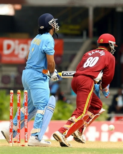 Dhoni is bowled by Hinds