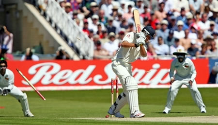 Cook is bowled by Malinga
