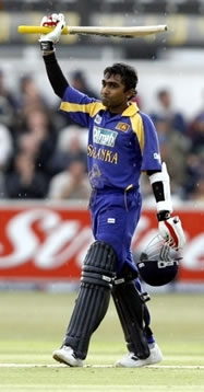 Jayawardene raises his bat after his century