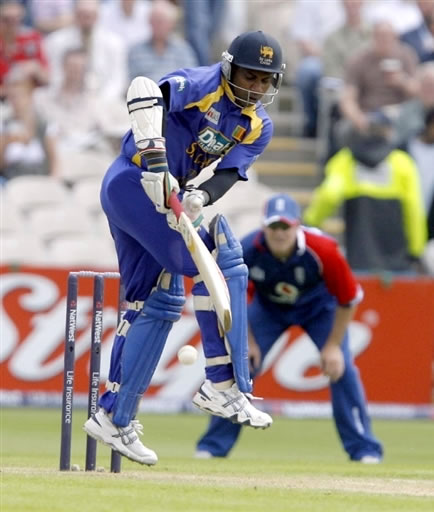 Jayasuriya jumps to defend a ball