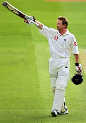 Collingwood raises his bat after his century