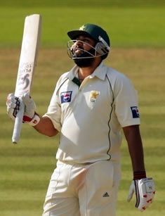 Inzamam-ul-Haq raises his bat after his half century